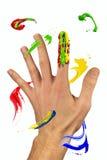 Κτυπήματα χρωμάτων που πετούν γύρω από το χέρι Στοκ Εικόνα