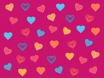 Πολύχρωμες καρδιές ένα ροδανιλίνης υπόβαθρο Στοκ Εικόνες