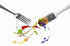 Παφλασμός χρωμάτων μεταξύ του δικράνου και του πινέλου Στοκ φωτογραφία με δικαίωμα ελεύθερης χρήσης