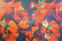 Πολύχρωμος του παραθύρου γυαλιού polygonal και των ψαριών Στοκ Φωτογραφία