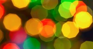 Πολύχρωμο υπόβαθρο διακοπών Χριστουγέννων bokeh ελαφρύ αφηρημένο Στοκ Εικόνες