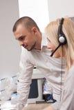 Πράκτορας τηλεφωνικών κέντρων στην εργασία Στοκ Εικόνες