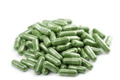 πράσινα απομονωμένα χάπια κ&al Στοκ Φωτογραφία