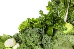 Πράσινα λαχανικά πέρα από το άσπρο υπόβαθρο Στοκ εικόνες με δικαίωμα ελεύθερης χρήσης