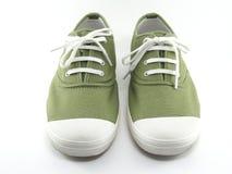 Πράσινα παπούτσια καμβά Στοκ Εικόνες