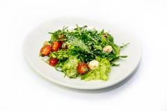 Πράσινα σαλάτας και ντομάτες κερασιών Στοκ Εικόνες