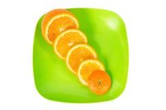 πράσινες πορτοκαλιές φέτες πιάτων Στοκ εικόνες με δικαίωμα ελεύθερης χρήσης