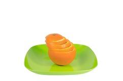 πράσινες πορτοκαλιές φέτες πιάτων Στοκ Φωτογραφίες