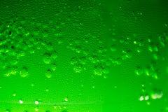 Πράσινες συμπύκνωση και φυσαλίδες διατρήσεων χυμού Στοκ Εικόνες