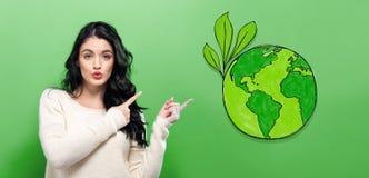 Πράσινη γη με τη νέα γυναίκα Στοκ εικόνα με δικαίωμα ελεύθερης χρήσης