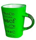 Πράσινη κούπα καφέ με τις επιγραφές στοκ εικόνα με δικαίωμα ελεύθερης χρήσης