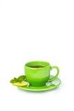 Πράσινη κούπα με το λεμόνι και τη μέντα Στοκ Εικόνες