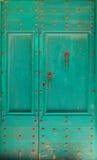 Πράσινη πόρτα Στοκ εικόνα με δικαίωμα ελεύθερης χρήσης