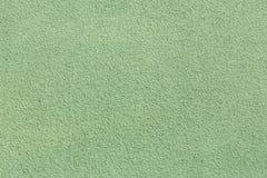 Πράσινη πλάτη σύστασης τοίχων ασβεστοκονιάματος Στοκ Φωτογραφία