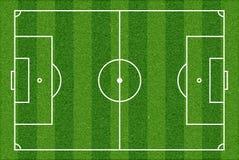 πράσινη σύσταση χλόης ποδοσφαίρου πεδίων ανασκόπησης Τοπ όψη Στοκ Φωτογραφίες