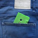 Πράσινη ταινία κασετών σε μια τσέπη Στοκ φωτογραφία με δικαίωμα ελεύθερης χρήσης