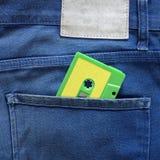 Πράσινη ταινία κασετών σε μια τσέπη Στοκ φωτογραφίες με δικαίωμα ελεύθερης χρήσης