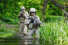 Πράσινοι Berets στρατιώτες στη δράση Στοκ Φωτογραφίες