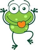 Πράσινος βάτραχος που κάνει τα αστεία πρόσωπα Στοκ Εικόνα