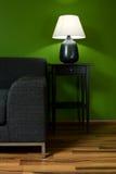 πράσινος καναπές δωματίων Στοκ εικόνες με δικαίωμα ελεύθερης χρήσης