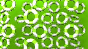 Πράσινος κολυμπήστε τα δαχτυλίδια στο πράσινο υπόβαθρο φιλμ μικρού μήκους