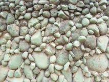 Πράσινο γκρίζο υπόβαθρο τοίχων πετρών στοκ εικόνες