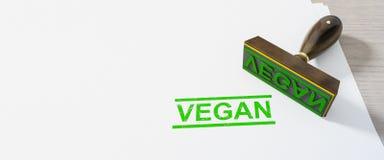 πράσινο γραμματόσημο vegan στο υπόβαθρο της Λευκής Βίβλου διανυσματική απεικόνιση