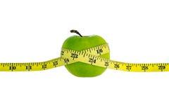 πράσινο λευκό ταινιών μέτρου ανασκόπησης μήλων Στοκ Φωτογραφίες
