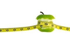 πράσινο λευκό ταινιών μέτρου ανασκόπησης μήλων Στοκ φωτογραφία με δικαίωμα ελεύθερης χρήσης