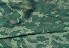 Πράσινο και καφετί σχέδιο υφασμάτων camoufklage χρώματος Στοκ εικόνα με δικαίωμα ελεύθερης χρήσης