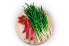 Πράσινο κρεμμύδι με το κόκκινο πιπέρι Στοκ Εικόνα