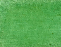 Πράσινο κλωστοϋφαντουργικό προϊόν χρώματος surfacr με τα σημεία και τις γρατσουνιές Στοκ Εικόνες