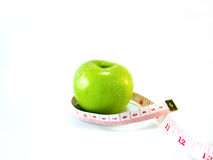 Πράσινο μήλο με το μέτρο Στοκ φωτογραφία με δικαίωμα ελεύθερης χρήσης
