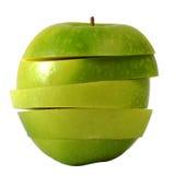 Πράσινο μήλο φωτογραφικών διαφανειών στη φέτα βημάτων Στοκ Φωτογραφίες