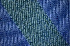 Πράσινο μπλε κατασκευασμένο χρωματισμένο κλωστοϋφαντουργικό προϊόν υποβάθρου χρωμάτων Στοκ Εικόνες