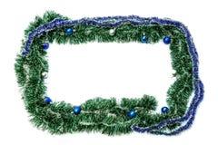 Πράσινο μπλε πλαίσιο με τις σφαίρες για το νέα έτος και τα Χριστούγεννα σε ένα μόριο Στοκ φωτογραφία με δικαίωμα ελεύθερης χρήσης