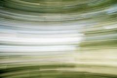 Πράσινο πάρκο φύσης θαμπάδων με το ελαφρύ αφηρημένο υπόβαθρο ήλιων bokeh Διάστημα αντιγράφων της περιπέτειας ταξιδιού και της ένν Στοκ Φωτογραφία