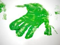 Πράσινο παιδί handprint που χρωματίζει Στοκ Φωτογραφία