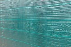 Πράσινο προστατευτικό καθαρό υπόβαθρο υφασμάτων Στοκ φωτογραφία με δικαίωμα ελεύθερης χρήσης
