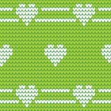Πράσινο πλεκτό άνευ ραφής σχέδιο με τις άσπρες καρδιές σχέδιο πλεκτό Στοκ Εικόνες