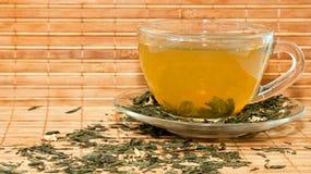 πράσινο τσάι φλυτζανιών στοκ φωτογραφία