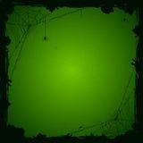 Πράσινο υπόβαθρο αποκριών με τις αράχνες Στοκ Εικόνες