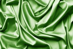 Πράσινο υπόβαθρο σύστασης μεταξιού ή σατέν στοκ φωτογραφία με δικαίωμα ελεύθερης χρήσης