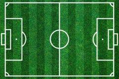 Πράσινο υπόβαθρο χλόης τομέων Soccerball Επίπεδος βάλτε Στοκ φωτογραφία με δικαίωμα ελεύθερης χρήσης