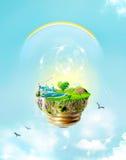Πράσινο concpet: ενέργεια, σύλληψη βολβών eco με το μπλε ουρανό φαντασίας, σύννεφα και ουράνιο τόξο Στοκ Εικόνα