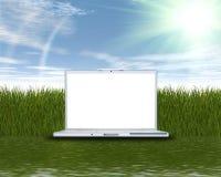 πράσινο lap-top χλόης υπολογιστών Στοκ Φωτογραφία