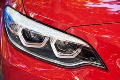 Προβολείς του κόκκινου αυτοκινήτου στοκ εικόνα