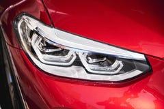 Προβολείς του κόκκινου αυτοκινήτου στοκ φωτογραφία με δικαίωμα ελεύθερης χρήσης