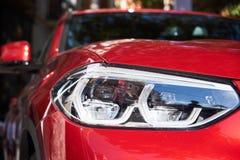 Προβολείς του κόκκινου αυτοκινήτου στοκ φωτογραφία