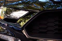 Προβολείς του μαύρου αυτοκινήτου στοκ φωτογραφίες με δικαίωμα ελεύθερης χρήσης